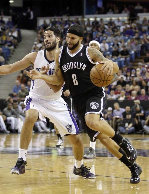 Nets guard Deron Williams, right, drives against Sacramento
