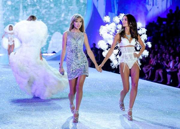 Taylor Swift, left, walks with model Lily Aldridge