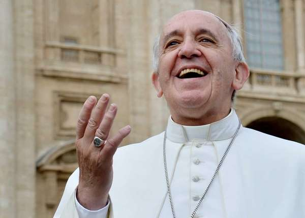 Pope Francis smiles to pilgrims in Saint Peter's