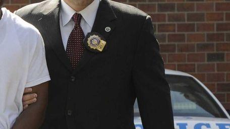 Former NYPD detective Rafael Astacio, of Copiague, was