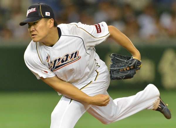 Japan's Masahiro Tanaka throws against the Netherlands in