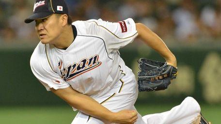 Japan's Masahiro Tanaka throws against the Netherlands in