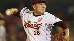 Rakuten Eagles pitcher Masahiro Tanaka hurls the ball