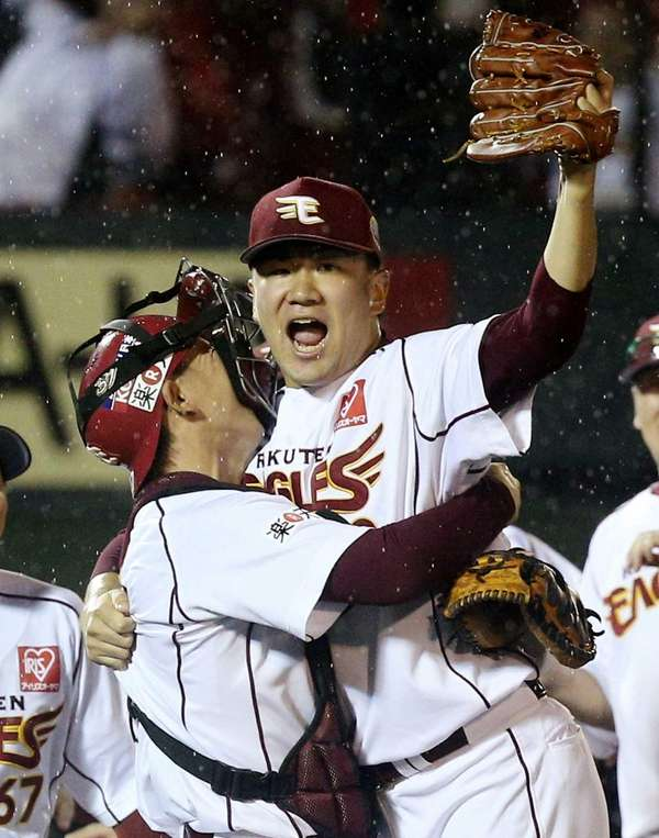 Rakuten Eagles pitcher Masahiro Tanaka, right, celebrates with