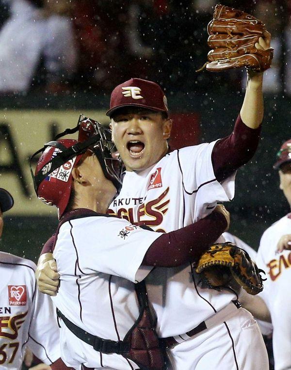 Rakuten Eagles pitcher Masahiro Tanaka, right, celebrates with