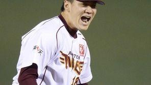Rakuten Eagles starter Masahiro Tanaka celebrates his complete-game