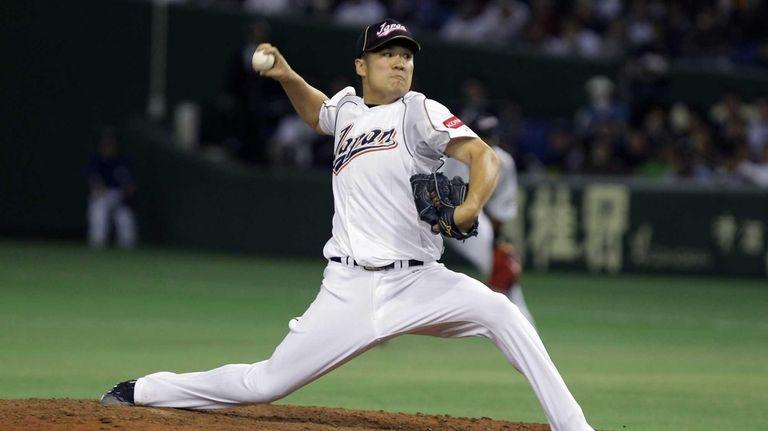 Masahiro Tanaka of Japan pitches in the fifth