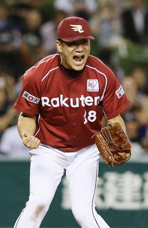 Rakuten Eagles pitcher Masahiro Tanaka celebrates after defeating