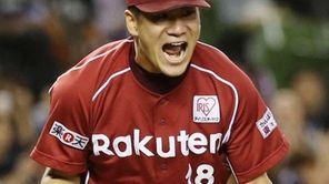 Rakuten Eagles pitcher Masahiro Tanaka celebrates after defeating