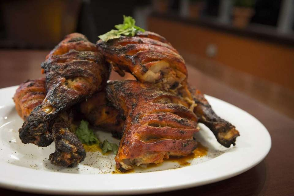Moist and well-spiced chicken tandoori at Fiza Family