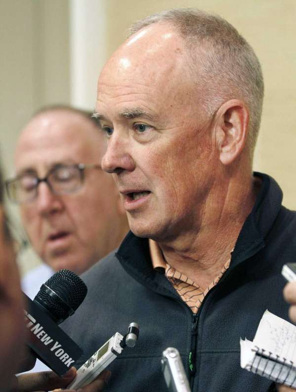 Sandy Alderson talks with the media at the