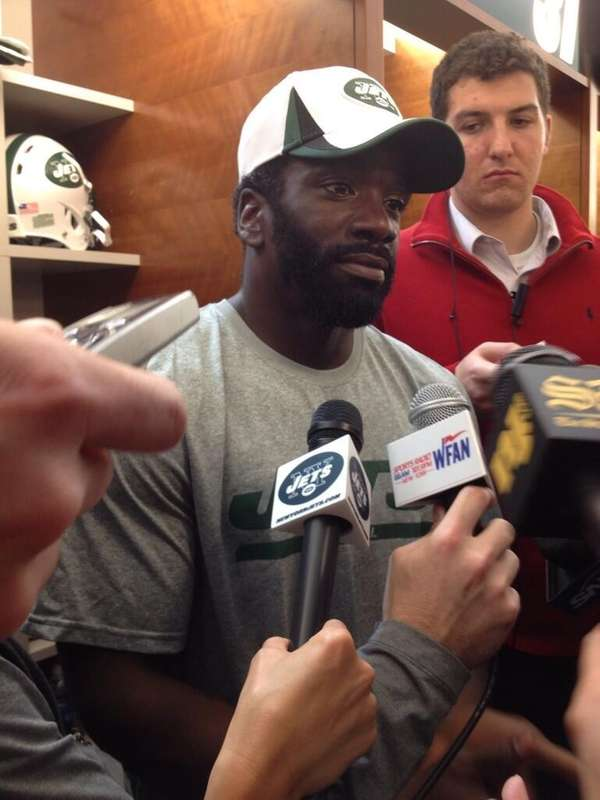 Ed Reed talks to the media on his