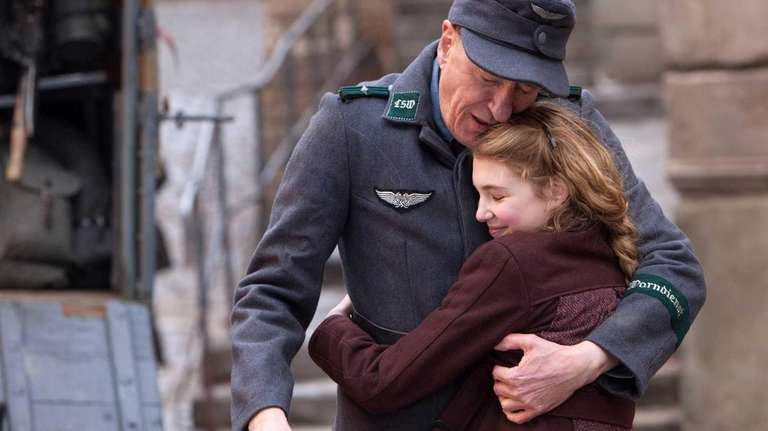 Geoffrey Rush, left, and Sophie Nélisse in a