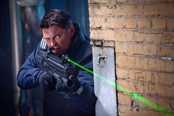 Karl Urban plays a part-human, part-machine cop in