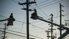 LIPA workers set up a temporary transformer station