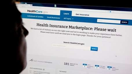 A woman looks at the HealthCare.gov insurance exchange