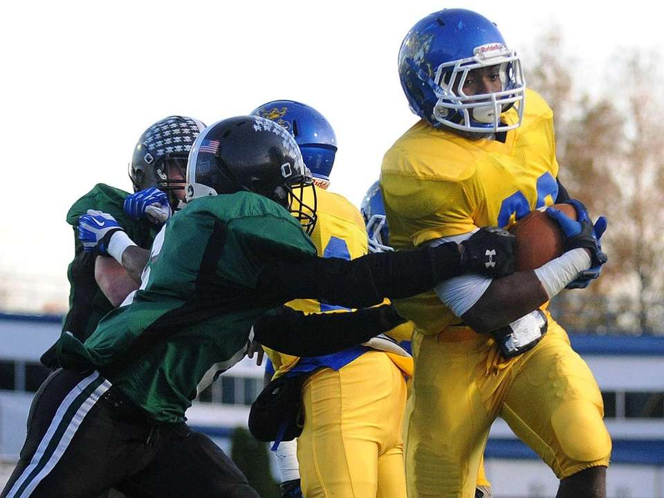 Roosevelt running back Johnnie Akins rushes for a