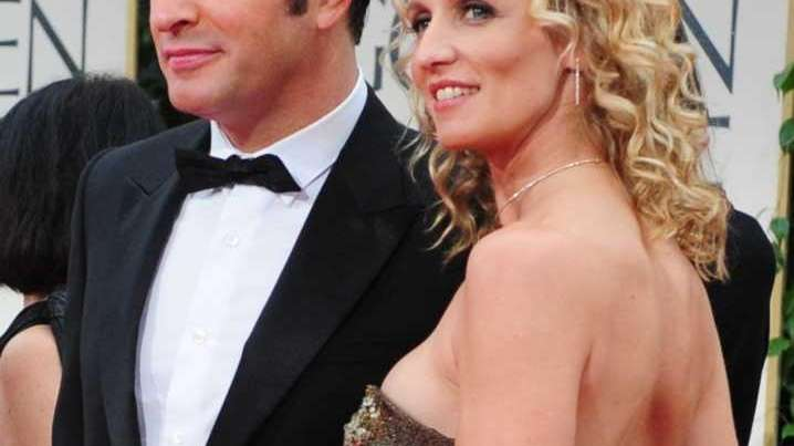 Jean Dujardin arrives with his wife, Alexandra Lamy,
