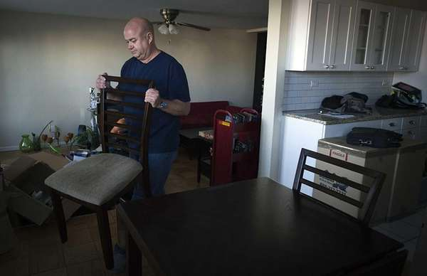 Long Beach resident Martin Kilkenny moves into his