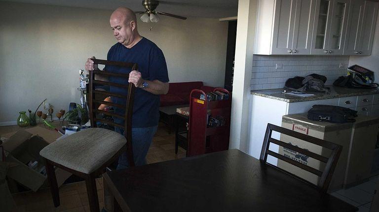Long Beach resident Martin Kilkenny moves into his