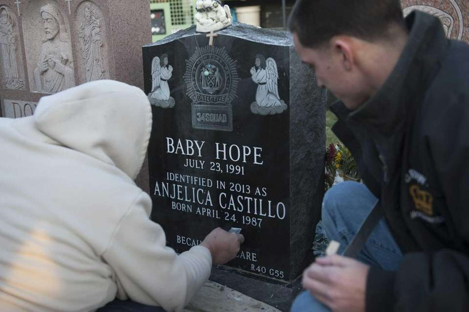 Stone cutters inscribe the name of Anjelica Castillo,