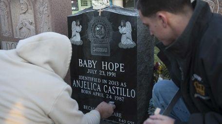 Stone cutters inscribe the name of Anjelica Castillo,