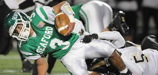 Seaford's Patrick Bizzarro fights for yards during the