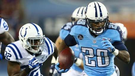 Chris Johnson of the Tennessee Titans carries the