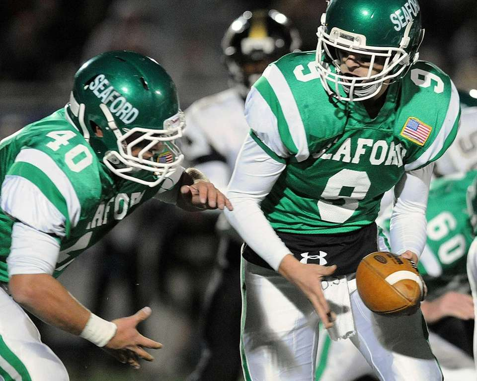 Seaford quarterback Kyle Kolodinsky, right, hands off to
