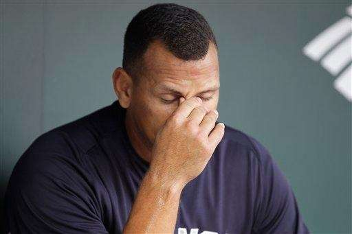 Alex Rodriguez rubs his face in the dugout
