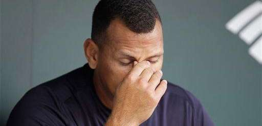 Alex Rodriguez in the dugout before a game