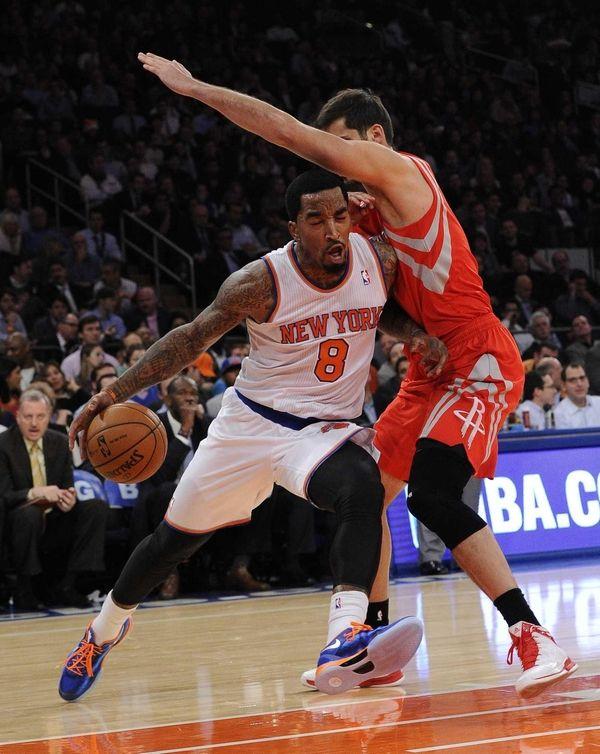 Knicks guard J.R. Smith drives past Houston Rockets