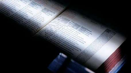 A scanner passes over a book at the