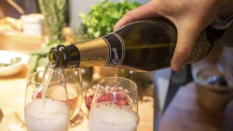 A 2008 Lenz Cuvee is poured for family