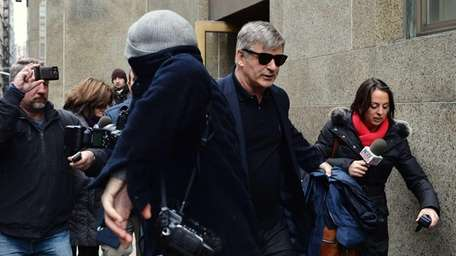 Alec Baldwin leaves Manhattan Criminal Court through a