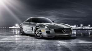 A 2014 Mercedes-Benz SLS AMG Black Series jumps