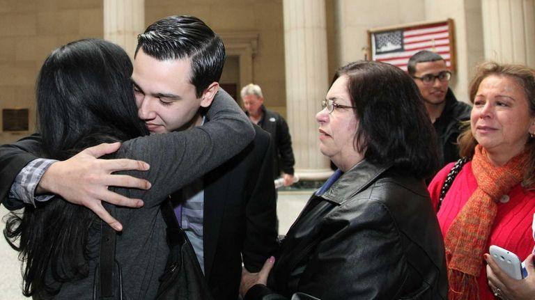 Jonathan Lopez hugs his mom Adriana Arbelaez after
