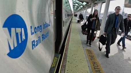 Commuters walk from a Long Island Railroad train