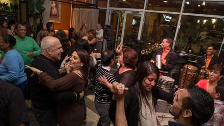 Patrons dance to live Latin music at the