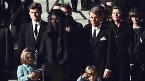 Three-year-old John F. Kennedy Jr. salutes his father's