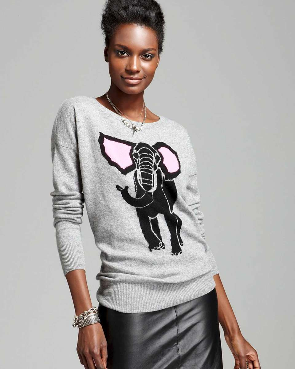 Aqua cashmere sweaters come in an elephant intarsia