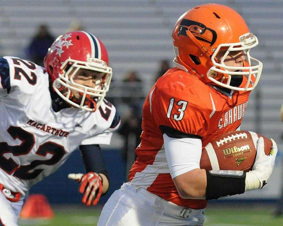 Carey's Nick Spillane rushes for a gain during
