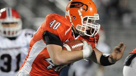 Carey's Conor Colasurdo carries the ball during the