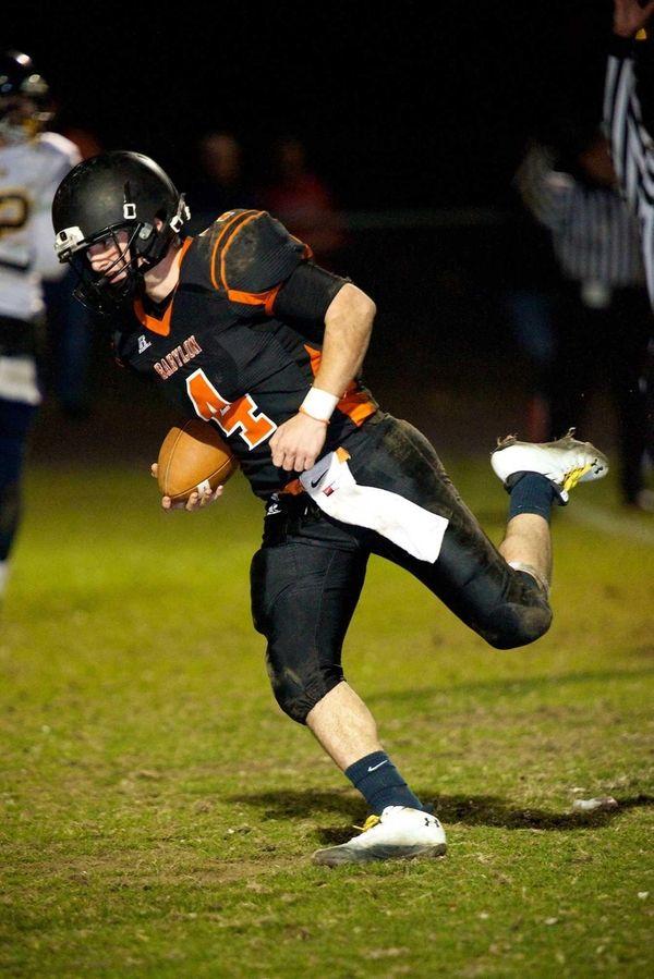 Babylon quarterback Nick Santorelli runs a quarterback keeper