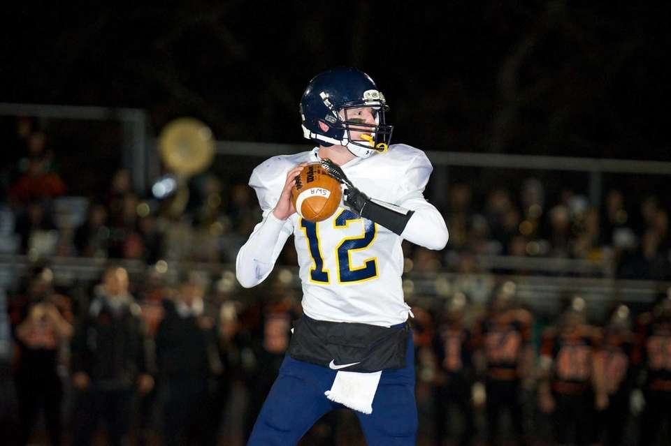 Shoreham Wading-River quarterback Daniel Hughes looks for an