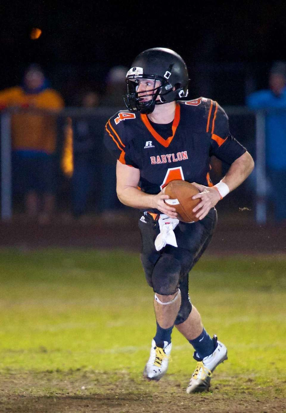 Babylon quarterback Nick Santorelli runs the ball for