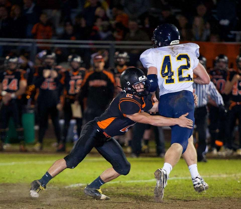 Babylon defensive back Luke Zappia puts the tackle