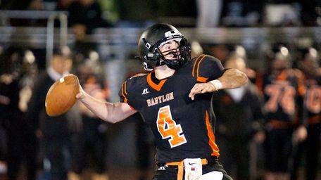 Babylon quarterback Nick Santorelli attempts a pass downfield.