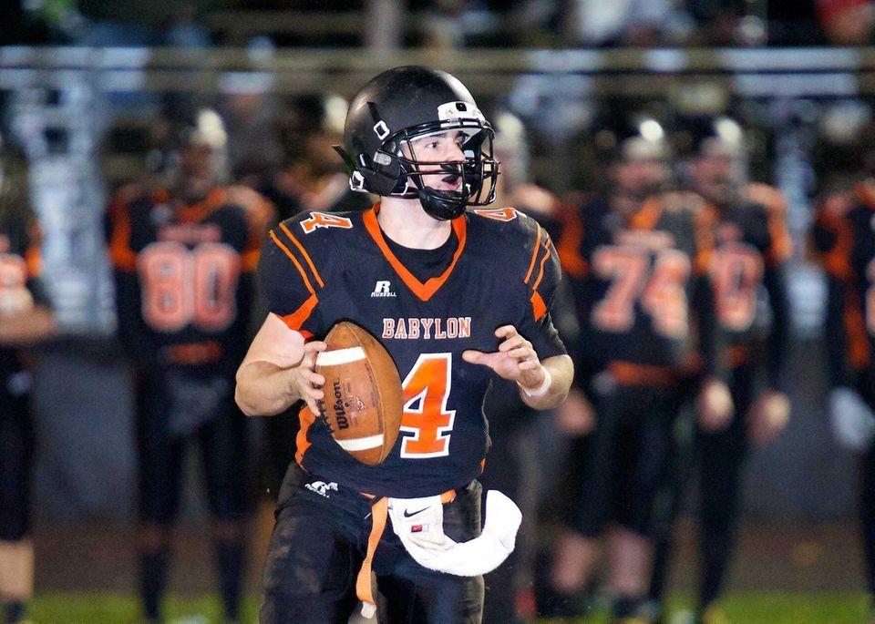Babylon quarterback Nick Santorelli looks for an open