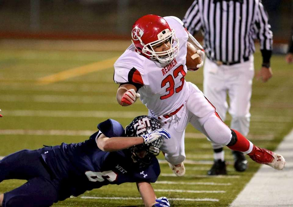 East Islip RB Erik Adon gets hit by